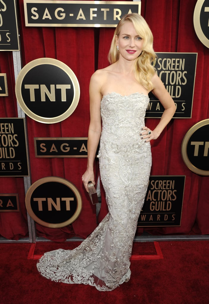 Naomi Watts struck a pose in a silver metallic embroidered Marchesa gown with dazzling Fabergé earrings.