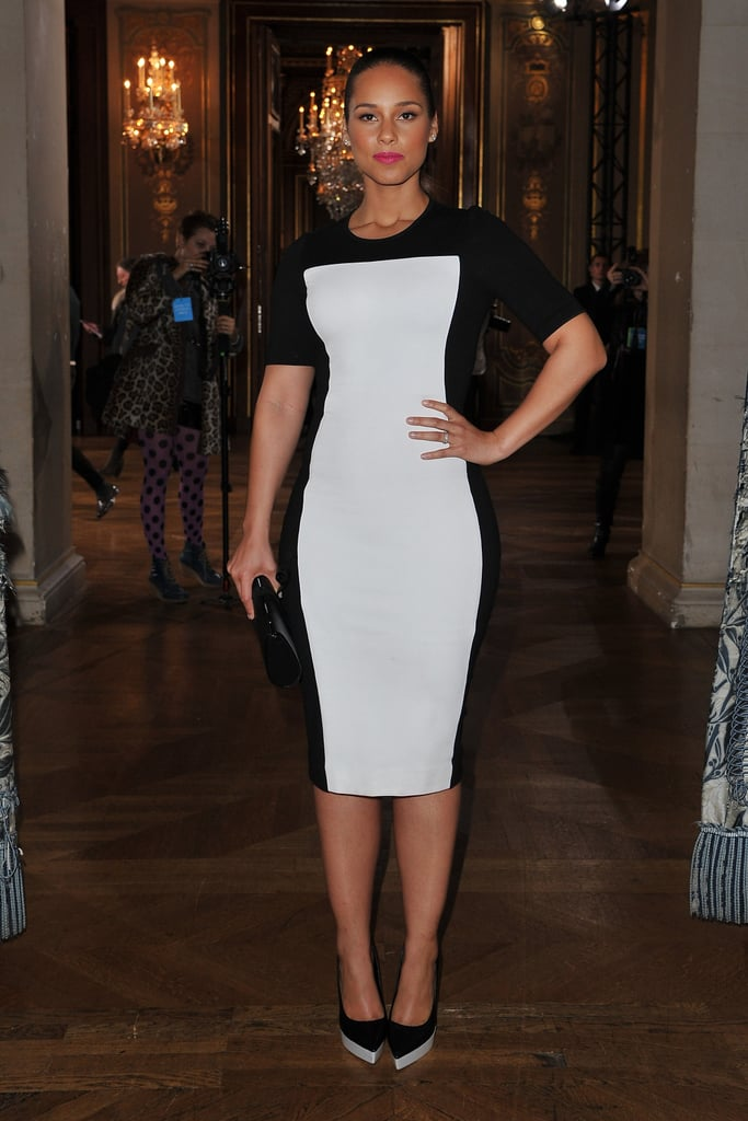 Alicia Keys changed into a two-tone form-fitting sheath for Stella McCartney.