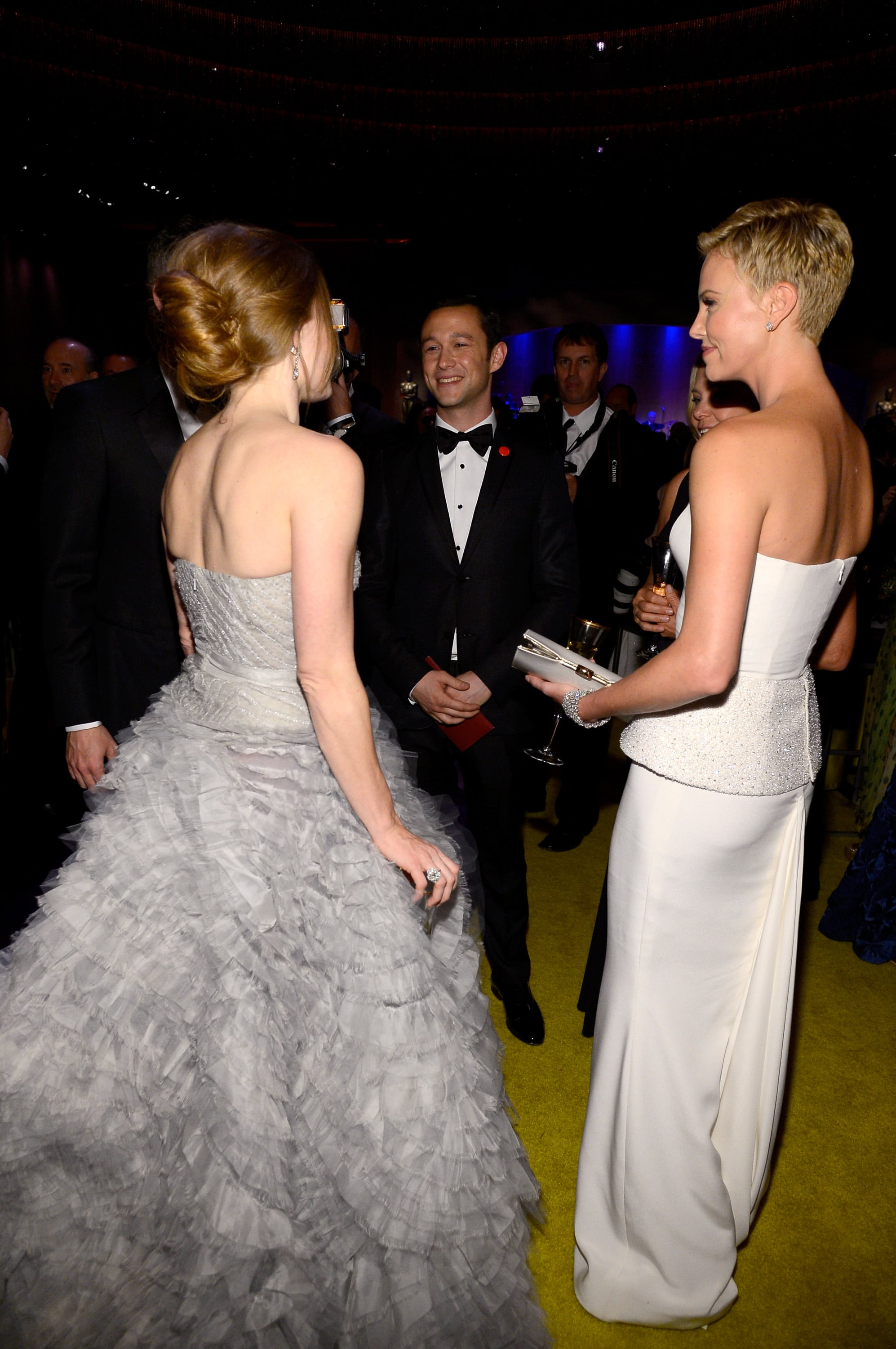 Charlize Theron and Amy Adams talked to Joseph Gordon-Levitt at the Governors Ball.
