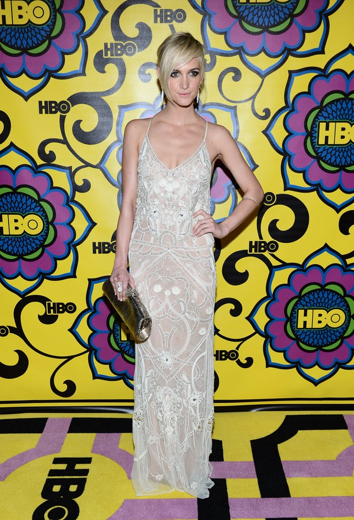 Ashlee Simpson wore an embellished white gown with a romantic, vintage feel.
