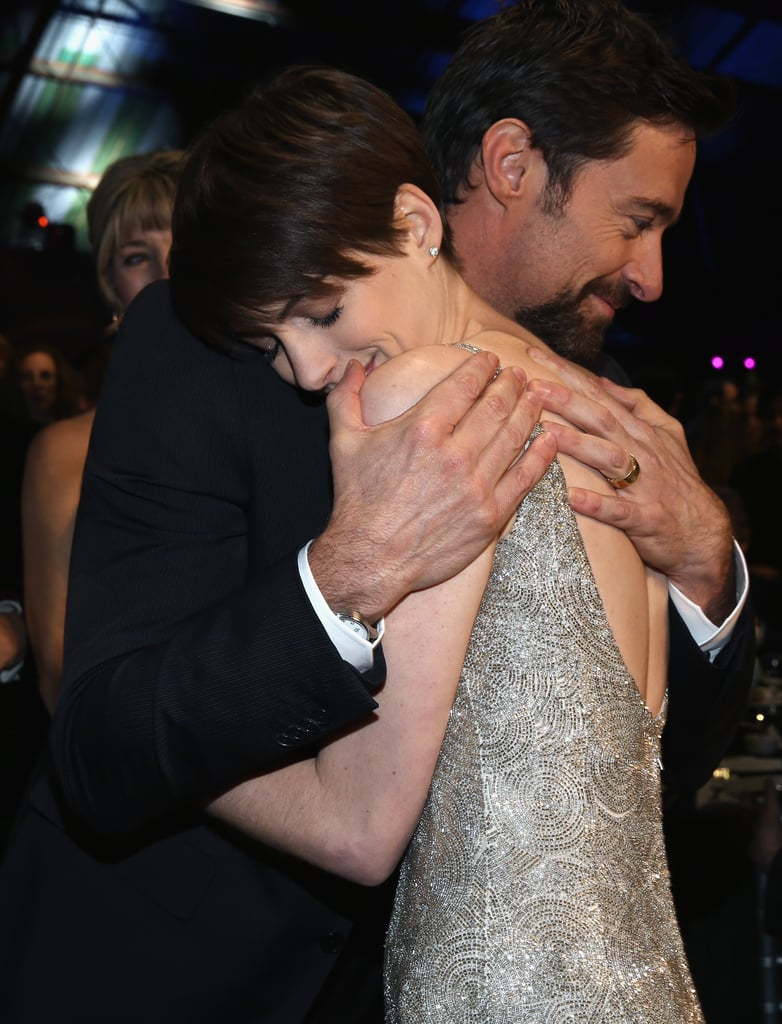 Hugh Jackman gave Anne Hathaway a sweet hug during the Critics' Choice Awards.