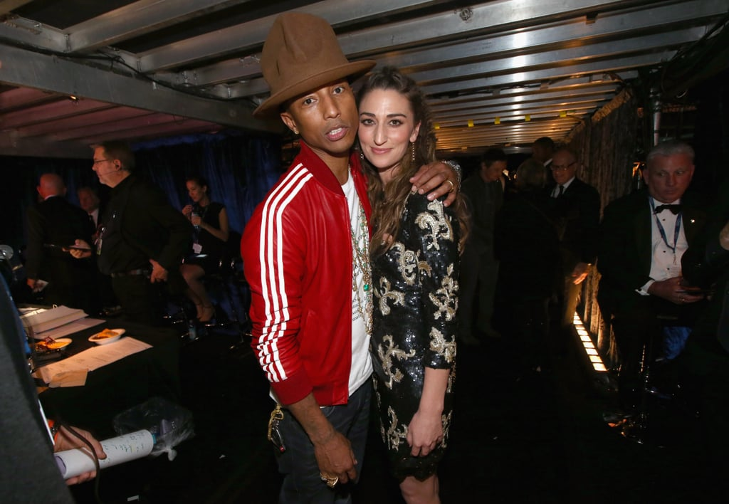 Pharrell took his hat backstage, where they posed with Sara Bareilles.