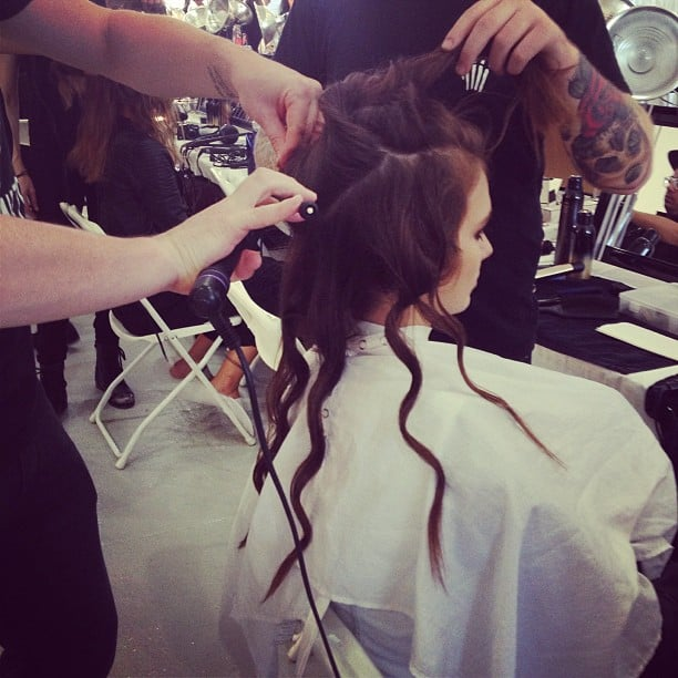 Stylists formed grungy waves in models' hair backstage at Rebecca Taylor.