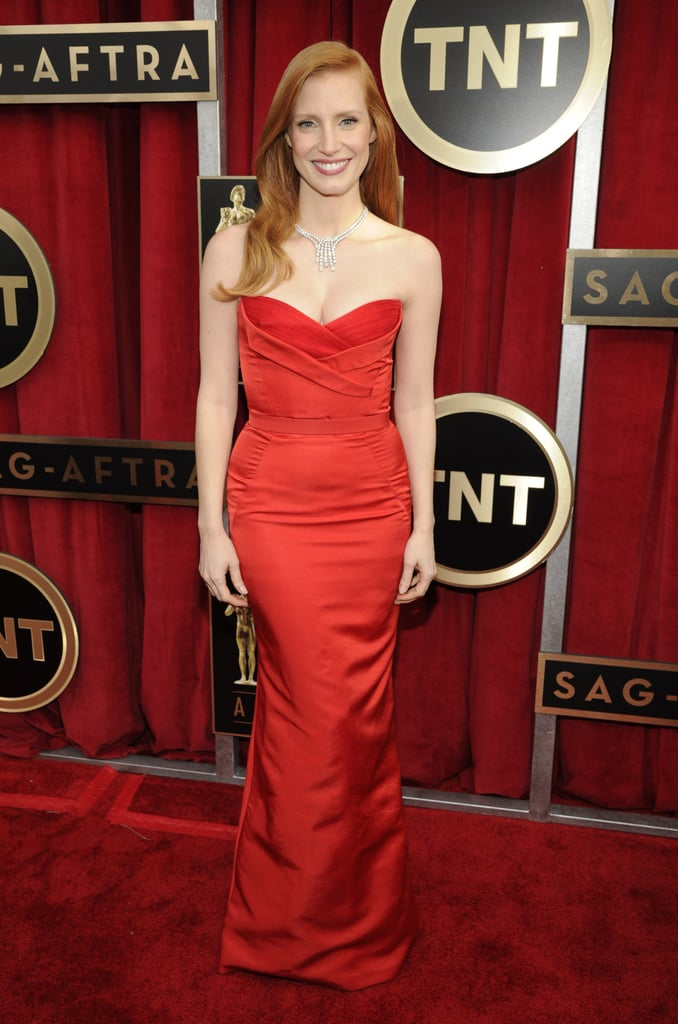 Jessica Chastain looked phenomenal in a red strapless Alexander McQueen number accessorised with a glistening Harry Winston necklace.