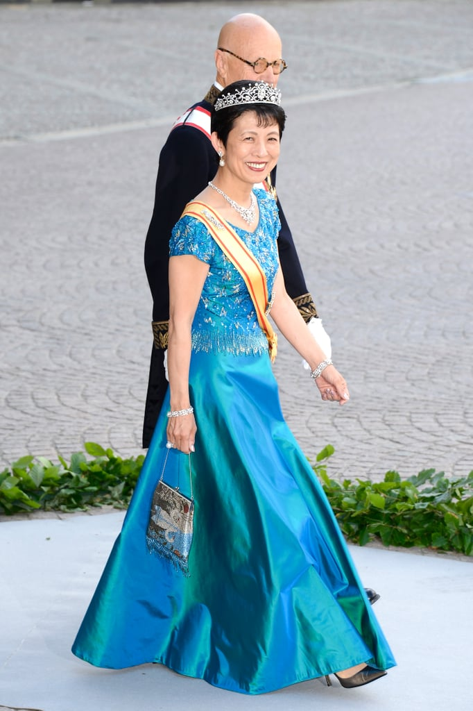 Princess Takamado of Japan wore a blue gown.