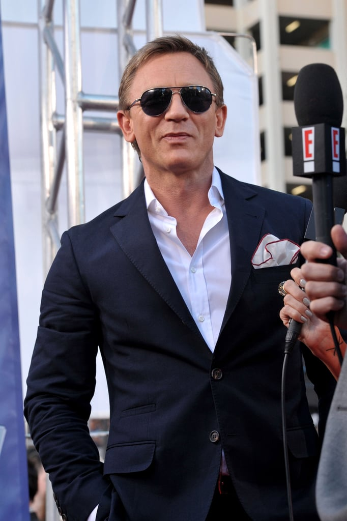 Daniel Craig kept his sunglasses on while posing for pictures.