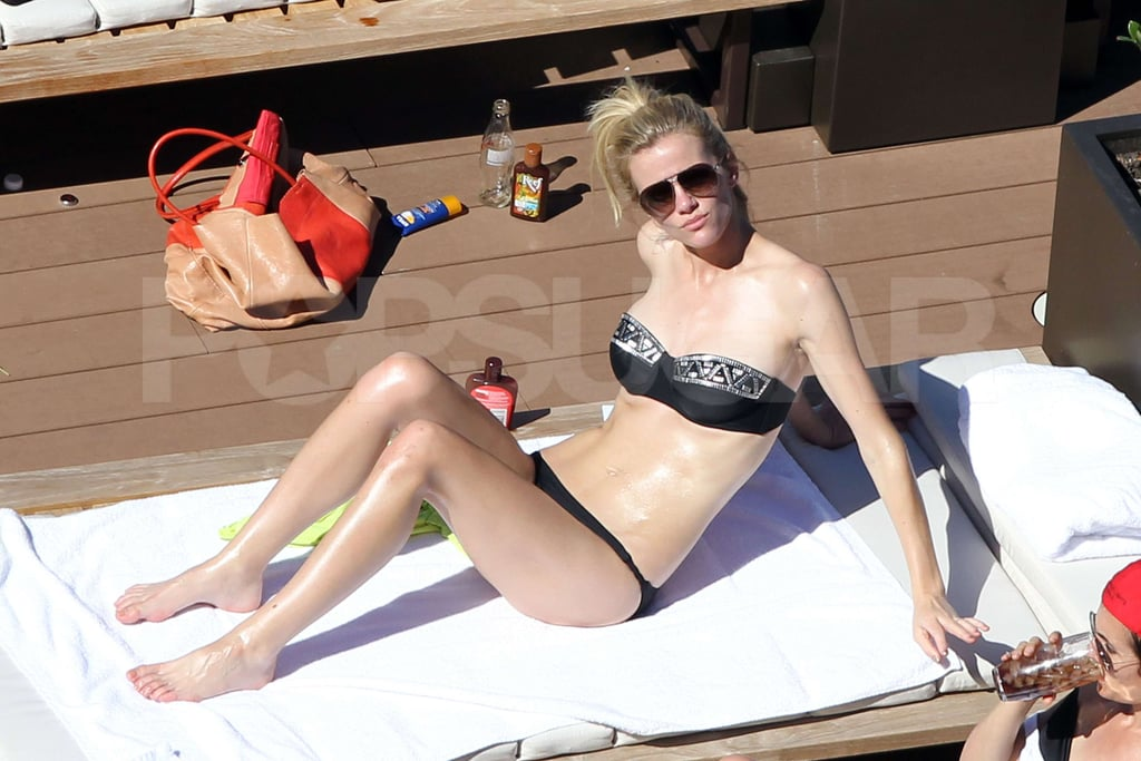 Brooklyn Decker relaxed by the pool in her bikini in Australia.