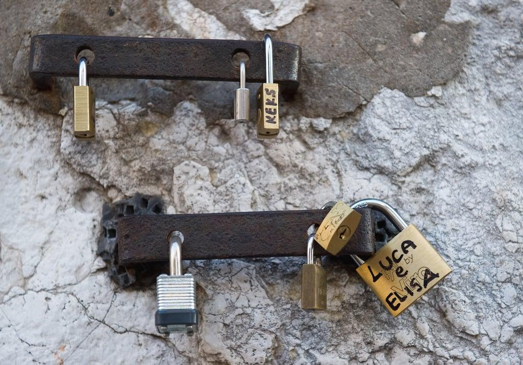 Love locks were attached to a wall on Rialto Bridge in Venice, Italy.