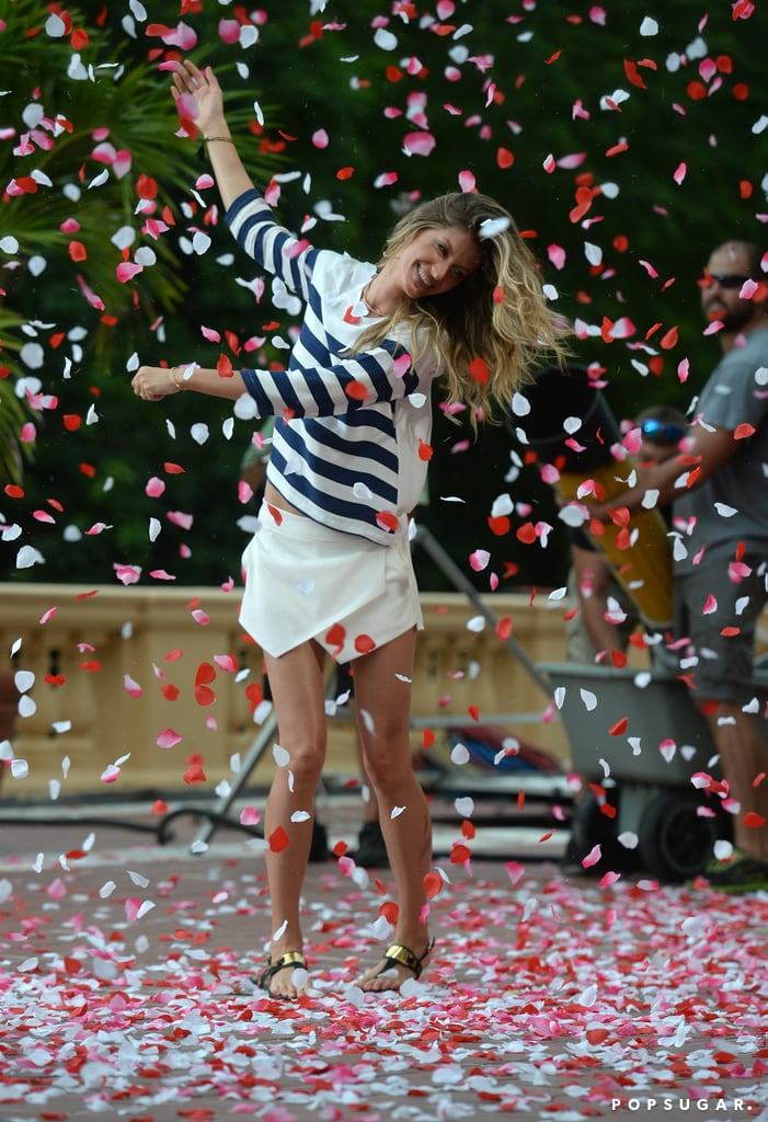 Gisele Bündchen danced around in rose petals during a photo shoot in Miami on Thursday.