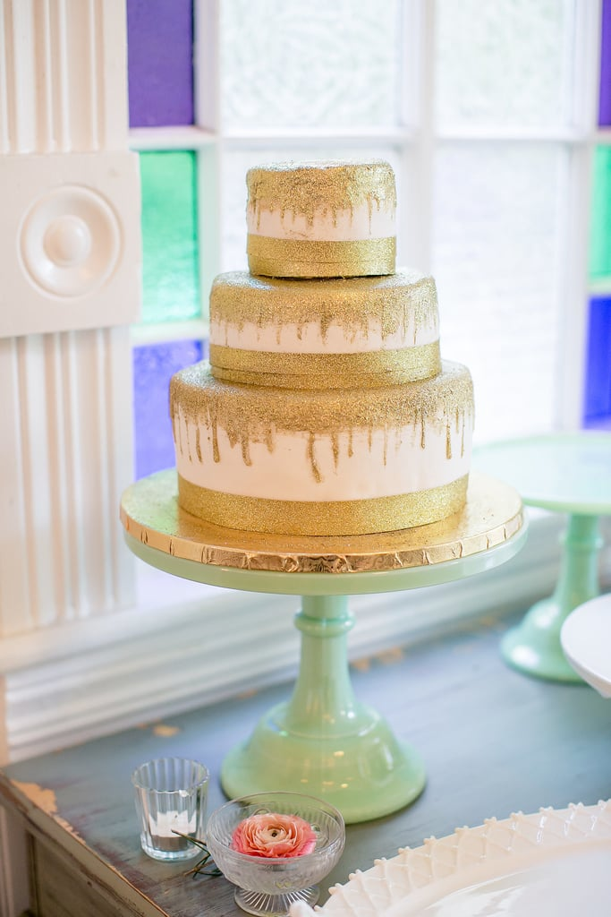 The sparkly gold details on this cake are so unexpected and fun — what else could you ask of your wedding-day dessert?