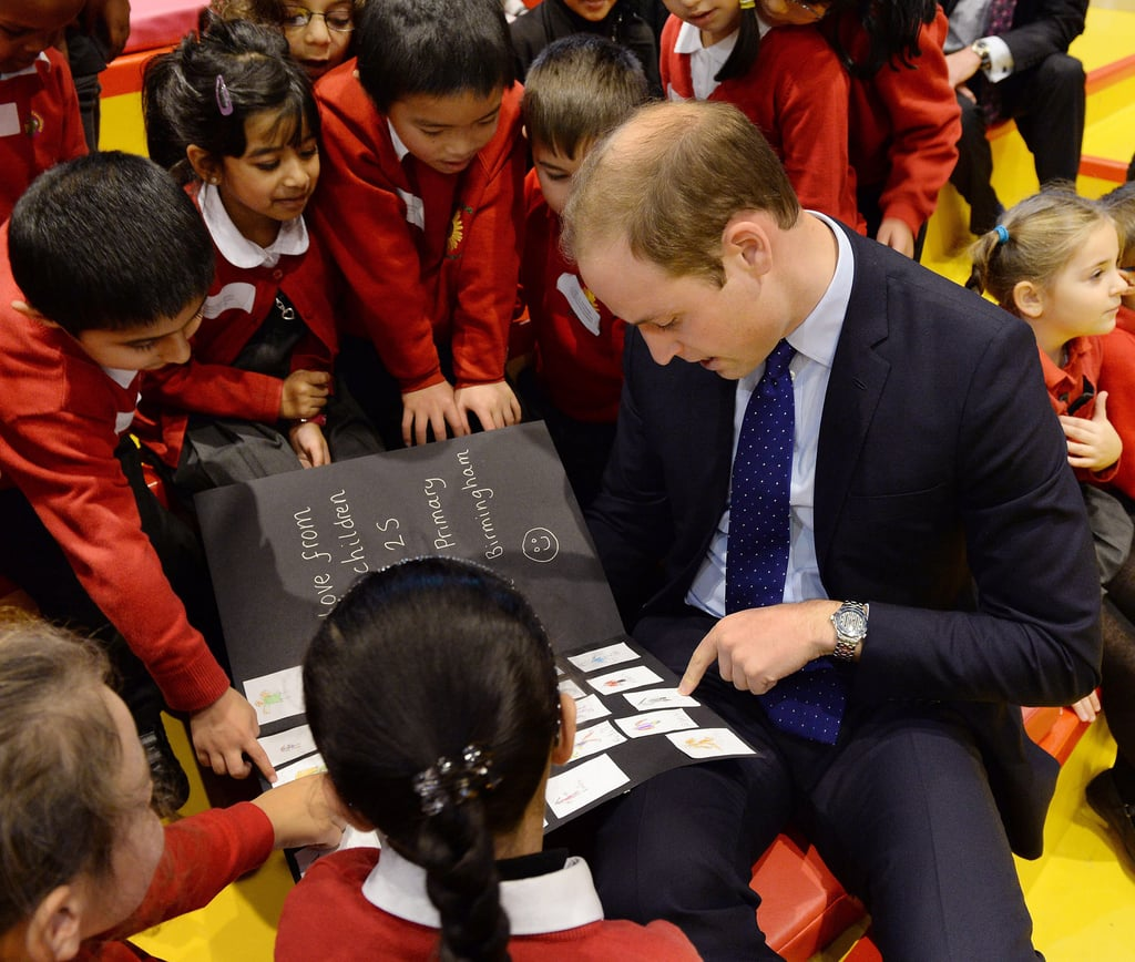 Prince William read a card made by the kids at Birmingham Library.