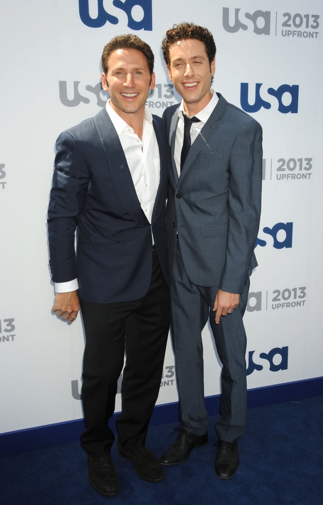 Mark Feuerstein and Paulo Costanzo hugged on the carpet.