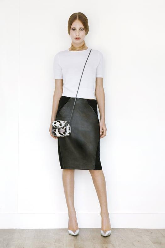 Short Sleeved Cashmere Tee in Cream ($295), Leather Slim Skirt in Black ($1,195), Treasure Cross Body Pony Bag in Cream Leopard ($795), Addiction Pump in Specchio ($595) Photo courtesy of Tamara Mellon