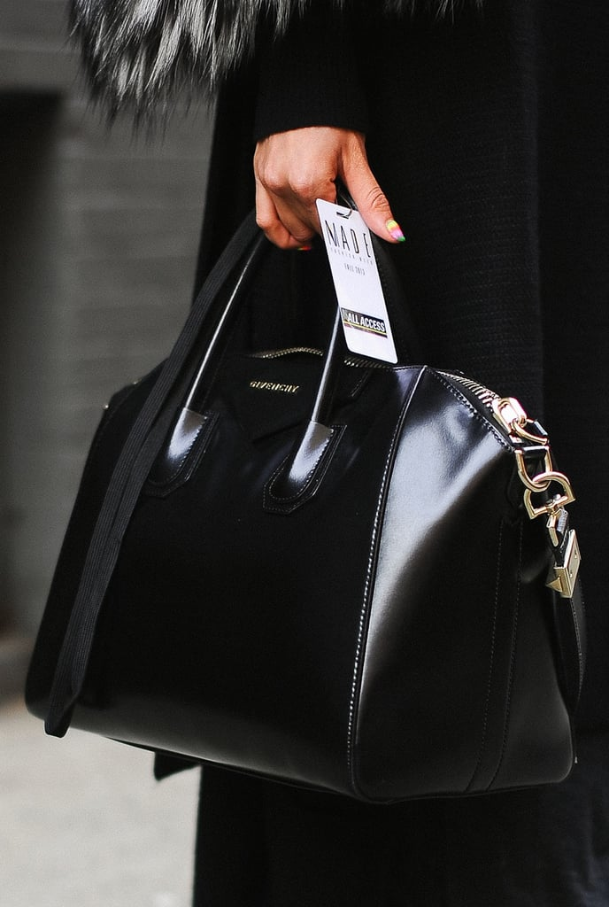 Black can be far from boring; just look at this supersleek black Givenchy duffel.