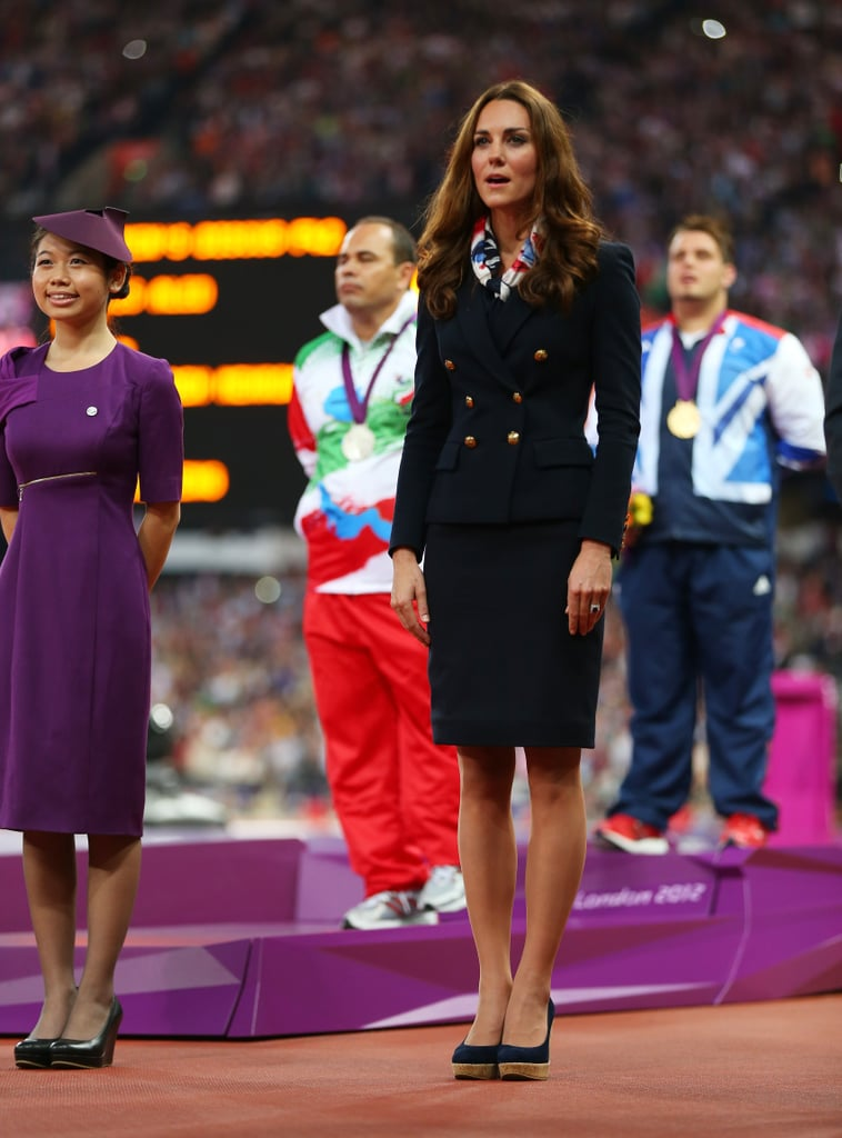 Kate stood at attention while handing out medals at the London Paralympics in August 2012.