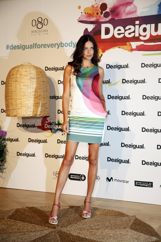 At Barcelona Fashion Week, Adriana Lima bared her gams in a printed sheath after walking the catwalk.
