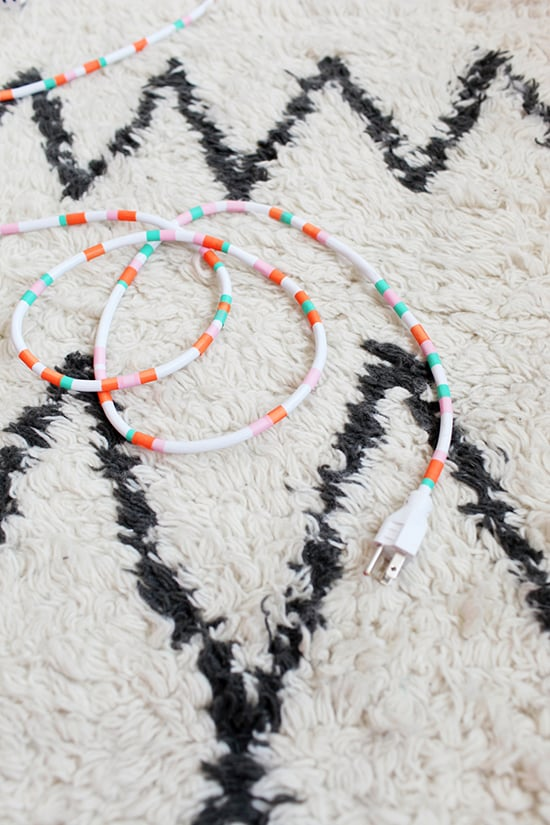 Ugly cords become decorative accessories thanks to this washi tape DIY! Source: Designlovefest