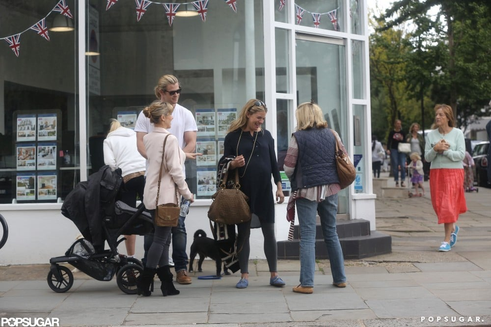 Chris Hemsworth and Elsa Pataky pushed baby India for a stroll and ran into Sienna Miller and her mother in London.