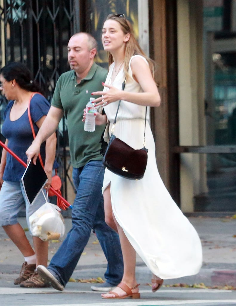 Amber Heard wore a flowing off-white dress in LA on Friday.