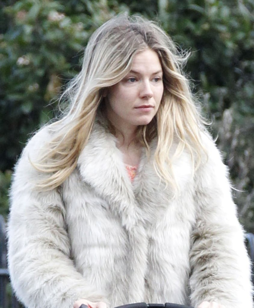 Sienna Miller walked with her daughter, Marlowe, in London.