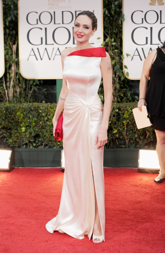 Angelina Jolie finished off her Versace look with a red clutch.