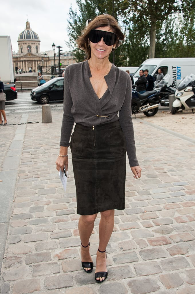 Carine Roitfeld, wearing her oversize sunglasses, paired a suede pencil skirt with the silkiest, slouchiest blouse. A perfect play on relaxed vs. formfitting silhouettes, if you ask us.