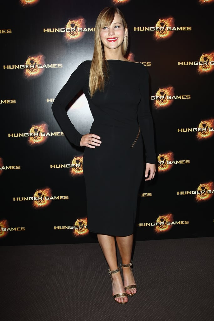 Jennifer Lawrence donned a Tom Ford slinky black dress with gold zipper details at the The Hunger Games Paris Premiere.
