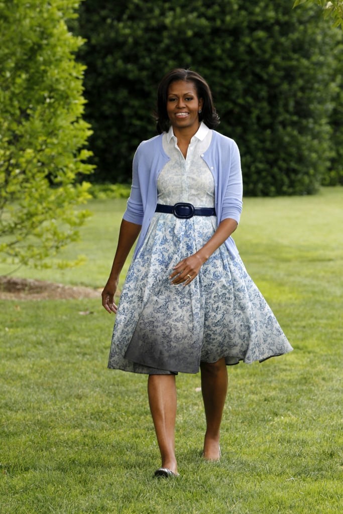 Michelle opted for a longer version of Boy by Band of Outsiders's popular toile-print sleeves cotton dress, which she paired with a patent belt, ballet flats, and a light-blue cardigan.