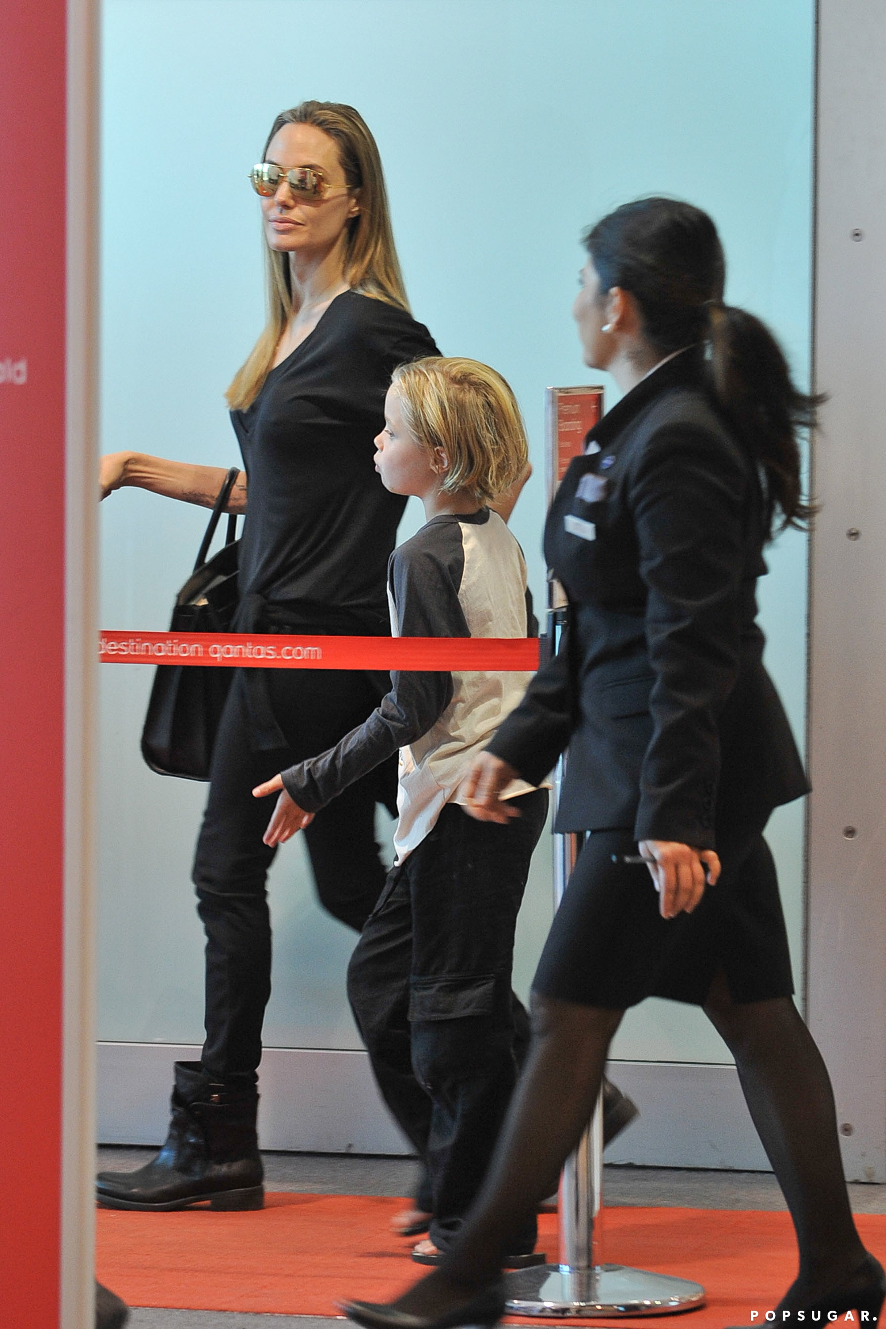 Angelina Jolie held her daughter Shiloh's hand as they boarded a plane in Sydney.