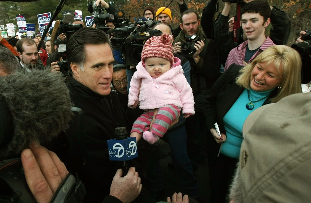 Mitt Romney held a baby during a visit to a Nashua, NH, polling station during the New Hampshire primary earlier this year.