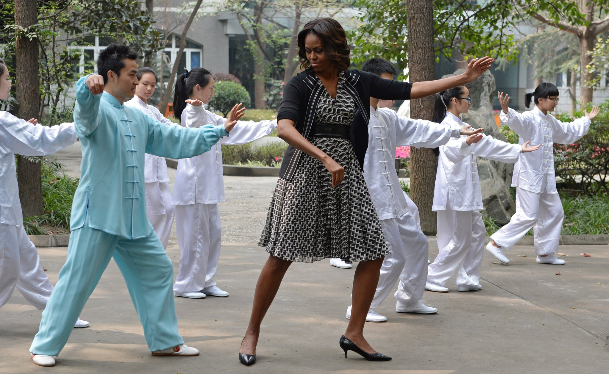 Michelle Obama tried her hand at tai chi with students at a Chengdu school.