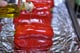 Clean the bell peppers and remove any stickers. Pat the peppers dry.  Preheat the oven to 450°F. Cover a cookie sheet with foil and drizzle olive oil over the red peppers.