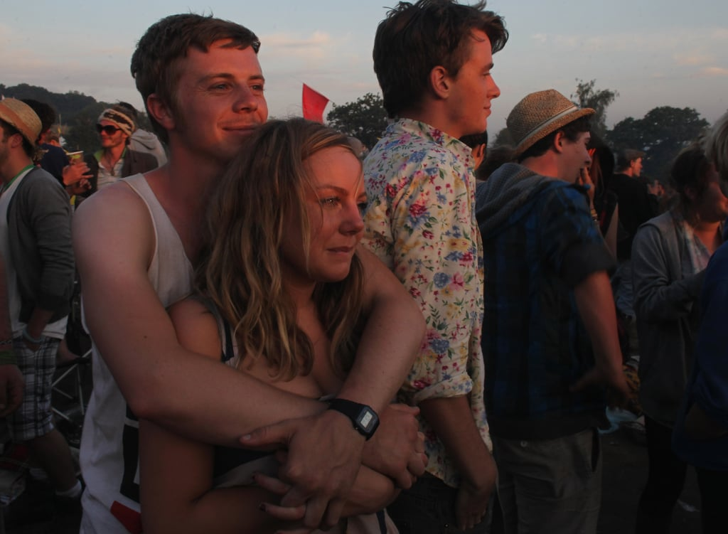 This pair got close to enjoy the sunrise together at the Glastonbury festival.