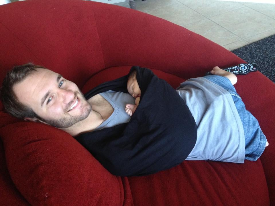 Motivational Speaker Nick Vujicic, Born Without Limbs, Holds His Child