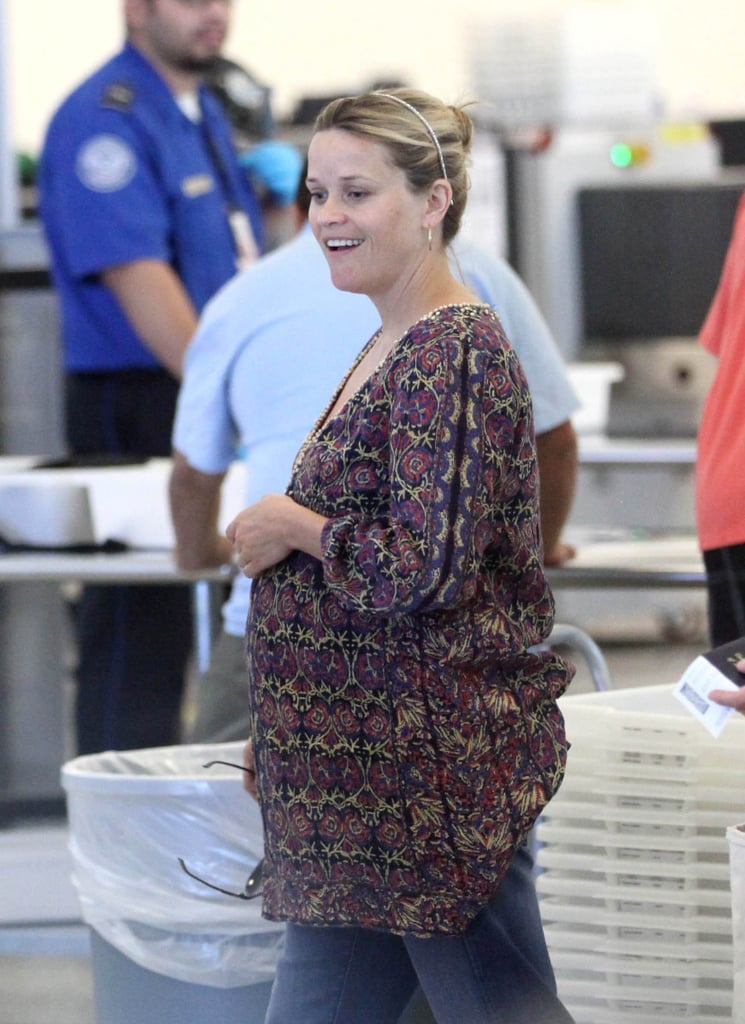 Reese Witherspoon pulled her hair back in a bun with a headband.