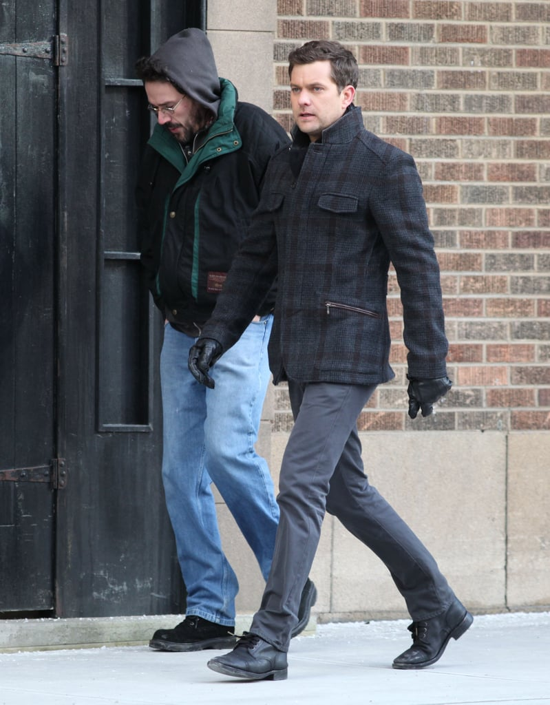 Joshua Jackson in a plaid coat.