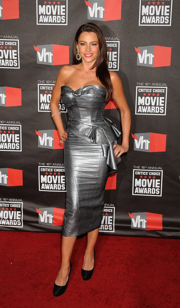 The actress went high-shine in a metallic Temperley London dress, diamond earrings, and black pumps for the 2011 Critics' Choice Awards.
