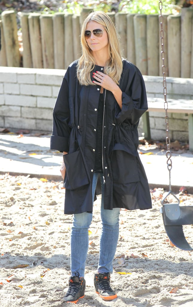 Heidi Klum paired a black anorak jacket with gray-and-orange sneakers while at a park in LA.