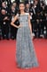 Zoe Saldana attended the 2013 premiere of Blood Ties in a Valentino gown featuring a decadently embroidered gunmetal-gray overlay.