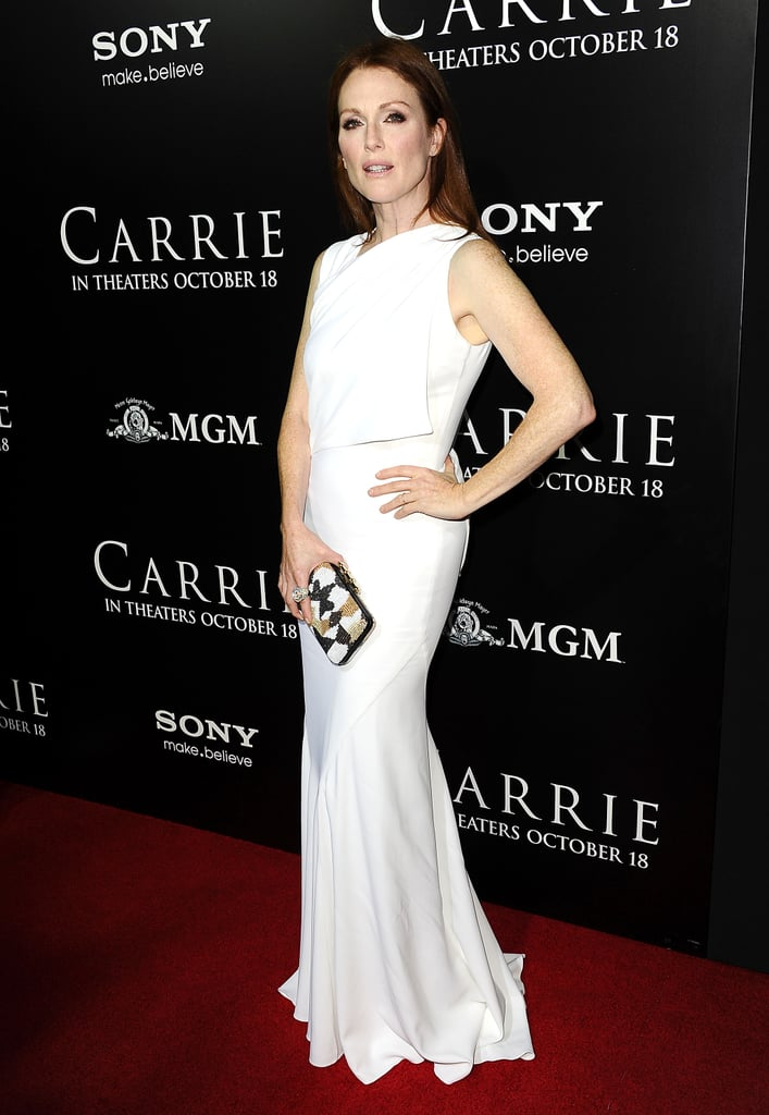 Also at the Carrie premiere, Julianne Moore picked a white Givenchy by Riccardo Tisci Fall 2013 gown and clutch and Harry Winston diamonds.