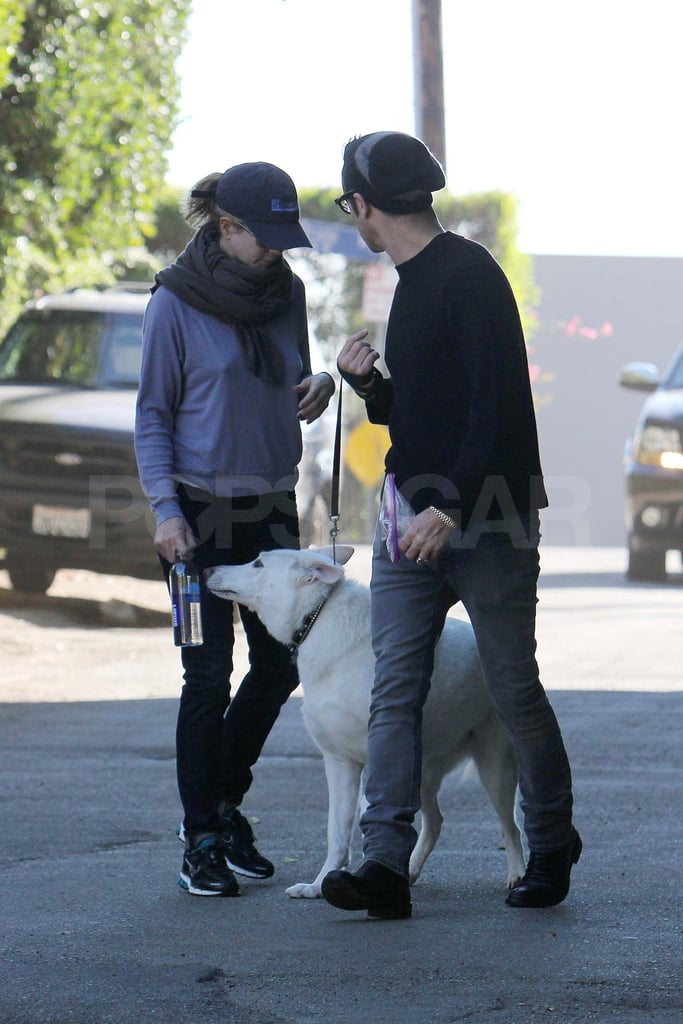 Jennifer Aniston and Justin Theroux on a walk with Dolly.