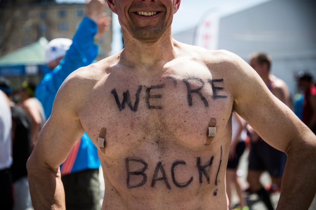 "A man wrote ""We're back!"" on his chest for the 2014 race."