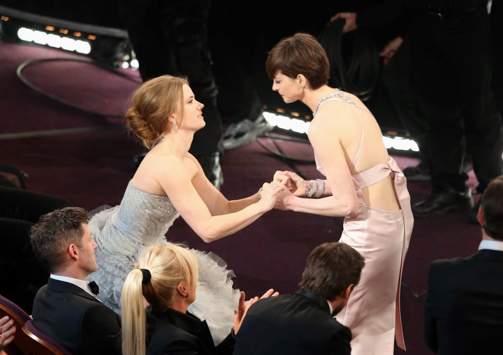 Nominee Amy Adams congratulated Anne Hathaway after her name was announced as the best supporting actress winner at the Oscars.
