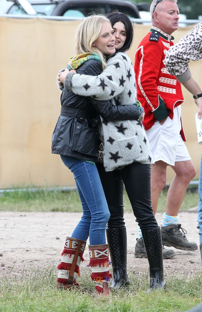 Pixie Geldof and Poppy Delevingne embraced at the farm.