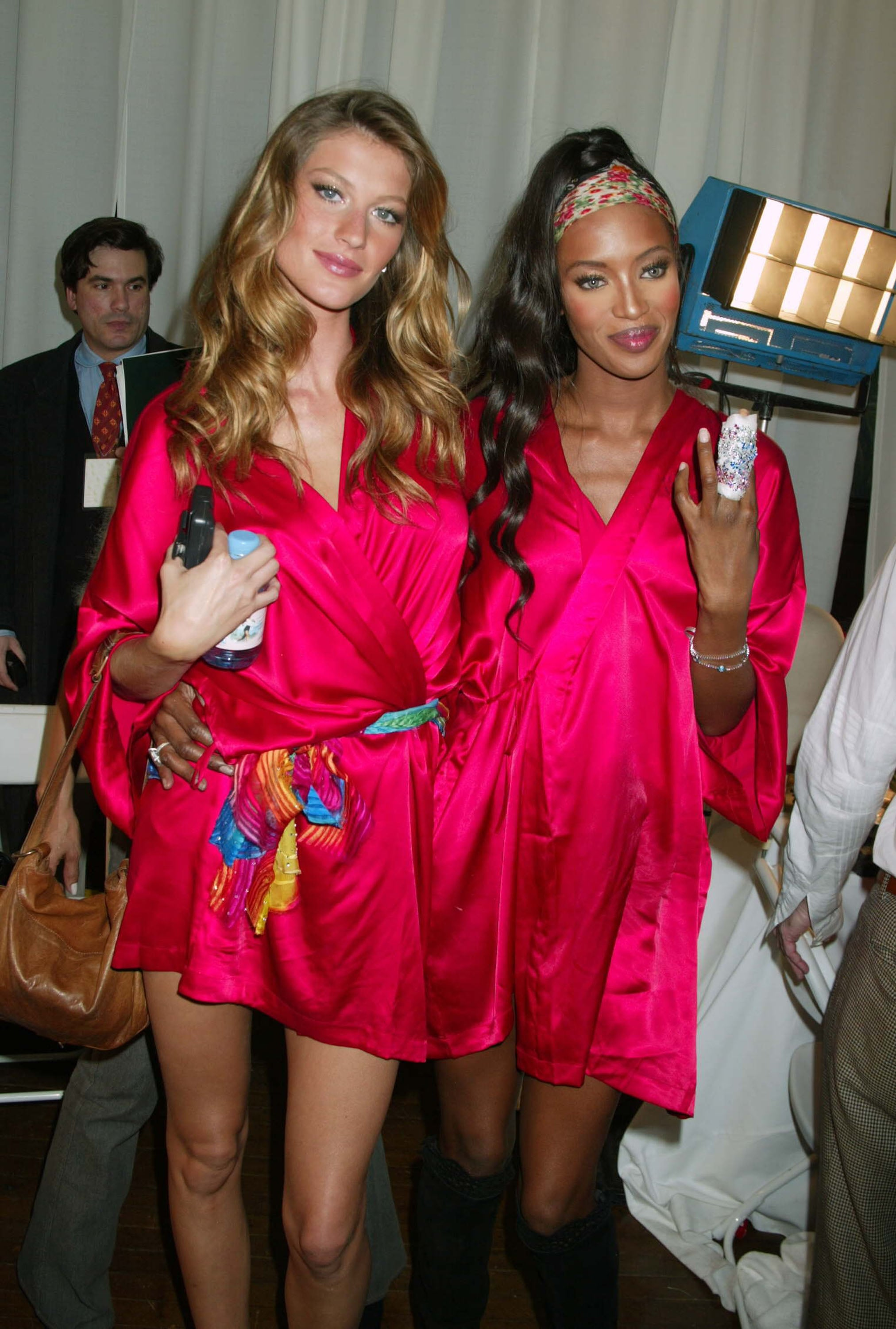Gisele and Naomi posed backstage together in 2003.