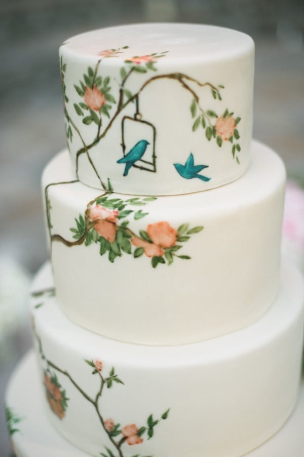 Painted wedding cakes are inherently special, and we think this particular one with its bird and floral design is just fabulous.