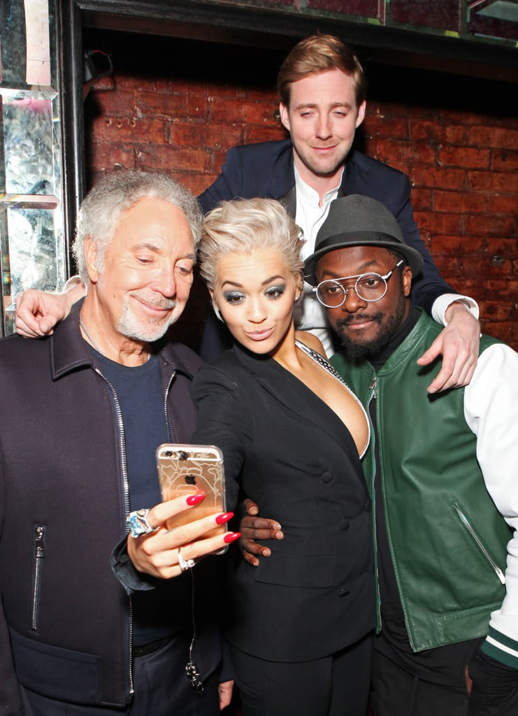 Rita Ora got a photo with Sir Tom Jones, Rocky Wilson, and will.i.am in London in March 2015.