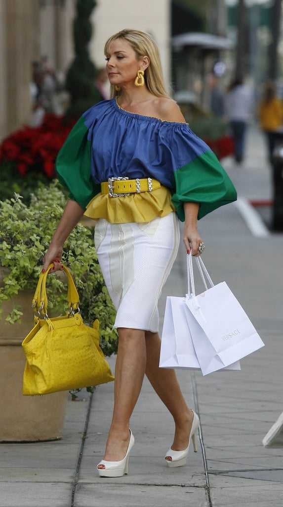It's all about colorblocking and volume here — from her off-the-shoulder blouse to her formfitting pencil skirt, this ensemble screams Samantha Jones.