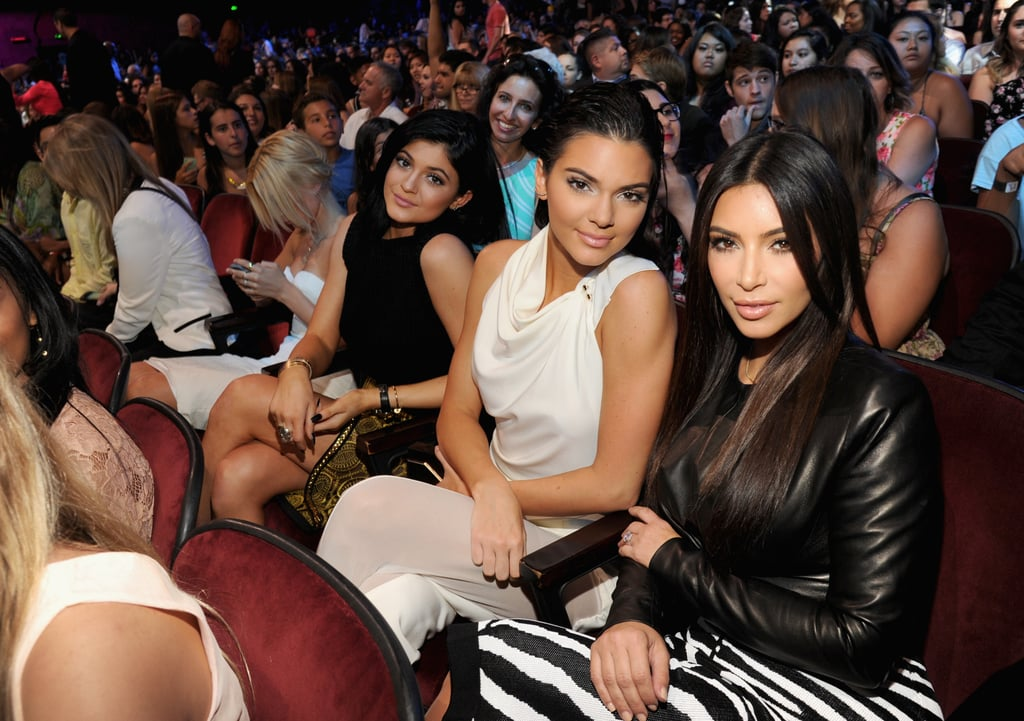 Kylie and Kendall Jenner coordinated ensembles with big sister Kim Kardashian in 2014.