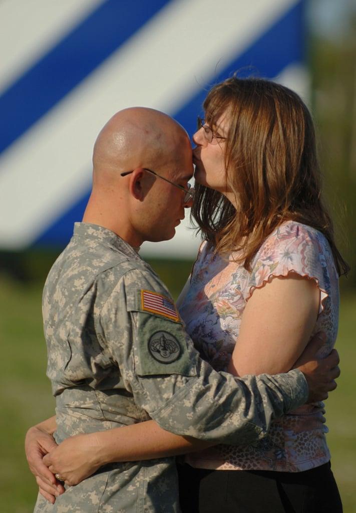 Sgt. Joshua Hanafin gets a kiss from wife Elizabeth on May 4, 2008, in Fort Stewart, GA.